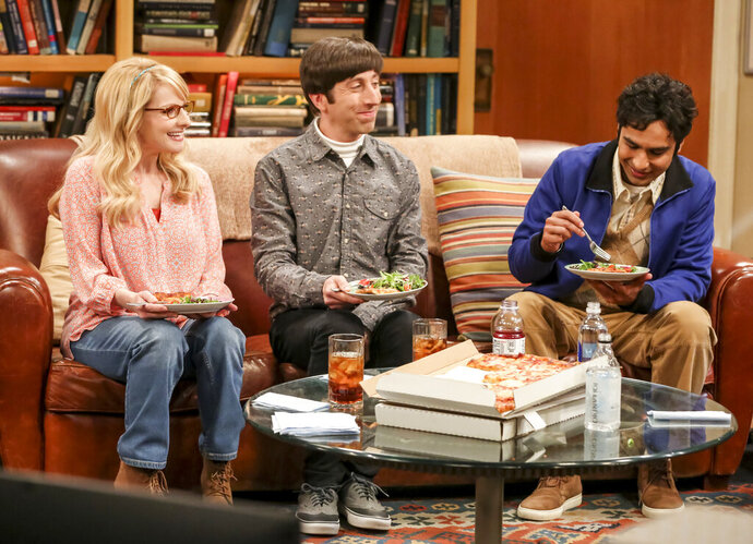 This photo provided by CBS shows Melissa Rauch, from left, Simon Helberg and Kunal Nayyar in a scene from