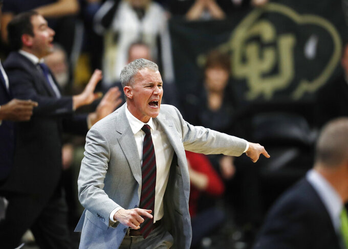FILE - In this March 9, 2019, file photo, USC head coach Andy Enfield disputes a call with referees in the second half of an NCAA college basketball game against Colorado in Boulder, Colo. Entering coach Enfield's seventh season, the Trojans haven't been to the NCAA Tournament since 2017. They're picked to finish fifth in the Pac-12 this season. After bringing in yet another highly regard recruiting class, he has reason to believe things could be different. (AP Photo/David Zalubowski, File)