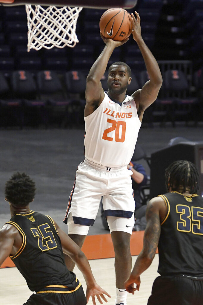 Illinois' Ayo Dosunmu (11) shoots as North Carolina's Tyler Maye (11) defends during the first half of an NCAA college basketball game, Wednesday, Nov. 25, 2020, in Champaign, Ill. (Photo/Holly Hart)