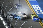 Denny Hamlin (11) squeezes between Ryan Newman (6) and Ryan Blaney (12) along the front stretch to win the NASCAR Daytona 500 auto race at Daytona International Speedway, Monday, Feb. 17, 2020, in Daytona Beach, Fla. (AP Photo/Phelan M. Ebenhack)
