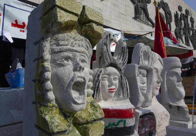 In this Tuesday, Dec. 17, 2019, photo, completed sculptures wait to be stored in preparation for an upcoming art exhibition, during the ongoing protests in Tahrir square, Baghdad, Iraq. Tahrir Square has emerged as a focus of the protests, with protesters camped out in dozens of tents. Dozens of people took part in the simple opening of the sculpture exhibition. (AP Photo/Nasser Nasser)