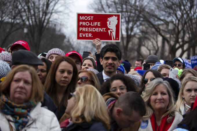 "FILE - In this Jan. 24, 2020, file photo, supporters listen as President Donald Trump speaks during the annual ""March for Life"" rally on the National Mall in Washington. Anti-abortion leaders across America were elated a year ago when Donald Trump became the first sitting U.S. president to appear in person at their highest-profile annual event, the March for Life held every January. The mood is more sober now — a mix of disappointment over Trump's defeat and hope that his legacy of judicial appointments will lead to future court victories limiting abortion rights. (AP Photo/ Evan Vucci, File)"