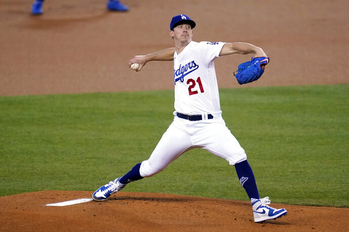 Los Angeles Dodgers starter Walker Buehler winds up during the first inning of the team's baseball game against the Oakland Athletics on Thursday, Sept. 24, 2020, in Los Angeles. (AP Photo/Marcio Jose Sanchez)
