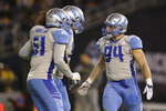 FILE - In this March 9, 2019, file photo, Salt Lake Stallions defensive end Karter Schult (94) celebrates his sack with Stallions Greer Martini (51) and another teammate in the first half of an AAF football game in San Diego.  Minnesota defensive end Karter Schult is one of the dozens of fringe players in NFL training camps this month who have been appreciating even the grind of two-a-day practices as much as anyone, given the setback their fledgling careers suffered this spring when the Alliance of American Football suddenly folded.  (AP Photo/Peter Joneleit, File)