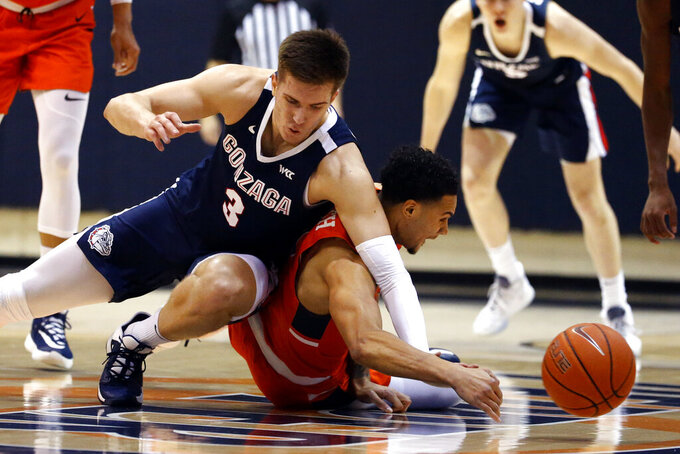 Gonzaga forward Filip Petrusev (3) collides with Pepperdine guard Keith Smith (11) during the first half of an NCAA college basketball game Saturday, Feb. 15, 2020, in Malibu, Calif. (AP Photo/Ringo H.W. Chiu)