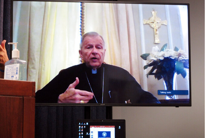 New Orleans Archbishop Gregory Aymond speaks at Louisiana Gov. John Bel Edwards' daily coronavirus press briefing via conference call on Friday, April 10, 2020, in Baton Rouge, La. Aymond is recovering from COVID-19. (AP Photo/Melinda Deslatte)
