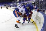 New York Rangers' Ryan Lindgren, right, holds on to New York Islanders' Ross Johnston (32 during the third period of an NHL hockey game Saturday, Jan. 16, 2021, in New York. (Bruce Bennett/Pool Photo via AP)