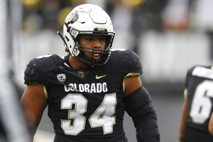 FILE - In this Saturday, Oct. 6, 2018, file photograph, Colorado defensive lineman Mustafa Johnson is shown in the first half of an NCAA college football game against Arizona State in Boulder, Colo. (AP Photo/David Zalubowski, File)