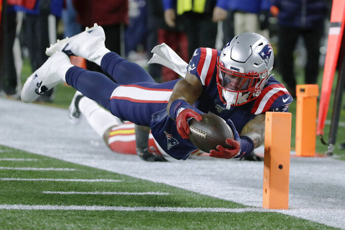 New England Patriots wide receiver N'Keal Harry dives for the pylon after catching a pass against the Kansas City Chiefs in the second half of an NFL football game, Sunday, Dec. 8, 2019, in Foxborough, Mass. The play was not ruled a touchdown. (AP Photo/Elise Amendola)
