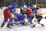 New York Rangers' Keith Kinkaid (71) covers the puck during the third period of an NHL hockey game against the Philadelphia Flyers at Madison Square Garden, Monday, March 15, 2021, in New York. (Bruce Bennett/Pool Photo via AP)