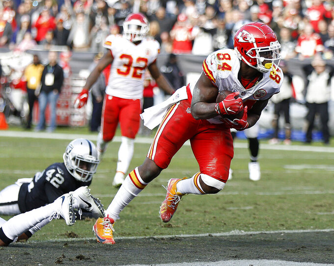 FILE - In this Dec. 2, 2018, file photo, Kansas City Chiefs tight end Demetrius Harris (84) scores against the Oakland Raiders during the second half of an NFL football game, in Oakland, Calif. A person familiar with the deal says the Cleveland Browns and free agent tight end Demetrius Harris have agreed to a two-year contract. Harris, who backed up Pro Bowler Travis Kelce in Kansas City, will be added to the roster when the NFL free agency signing period begins at 4 p.m. Wednesday, March 13, 2019, said the person who spoke on condition of anonymity to The Associated Press because teams are not permitted to announce any moves until later. (AP Photo/D. Ross Cameron, File)