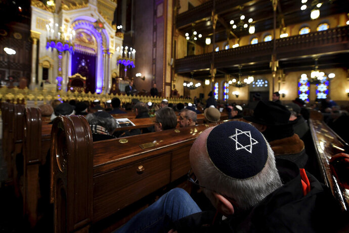 People attend a ceremony that commemorates the 75th anniversary of the liberation of the Budapest Jewish ghetto in Dohany Street Synagogue in Budapest, Hungary, Sunday, Jan. 19, 2020. The ghetto was liberated by the Soviet Red Army during World War II on January 17, 1945. (Tibor Illyes/MTI via AP)