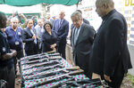 United Nations Secretary-General Antonio Guterres, center-right, views decommissioned weapons at a center for ex-combatants at Muningi, near Goma, in eastern Congo Saturday, Aug. 31, 2019. Guterres is starting a three-day visit to Congo to see the work of UN peacekeepers, work on disarmament and reintegration of ex-combatants, and efforts to stop the spread of the Ebola virus. (AP Photo/Justin Kabumba)
