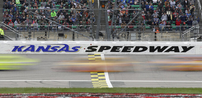 Drivers cross the start/finish line early in theNASCAR Cup Series auto race at Kansas Speedway in Kansas City, Kan., Saturday, May 11, 2019. (AP Photo/Orlin Wagner)