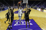 Kansas State's David Sloan (4) puts up a shot during the second half of an NCAA college basketball game against Alabama State Wednesday, Dec. 11, 2019, in Manhattan, Kan. (AP Photo/Charlie Riedel)