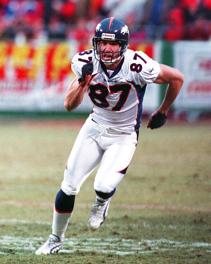 FILE - In this Jan. 4, 1998, file photo, Denver Broncos wide receiver Ed McCaffrey runs a pass route during and AFC Divisional playoff NFL football game against the Kansas City Chiefs in Kansas City. Luke McCaffrey, the younger brother of the Carolina Panthers star Christian McCaffrey and son of former NFL receiver Ed McCaffrey, made an unexpected entrance for Nebraska against Indiana last week and turned in a strong performance. (AP Photo/Ron Heflin, File)