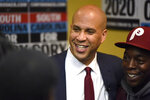 Democratic presidential contender Cory Booker poses for photos after a black men's round table on Monday, Dec. 2, 2019, in Columbia, S.C. (AP Photo/Meg Kinnard)
