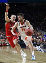 Virginia guard Ty Jerome drives past Texas Tech guard Matt Mooney, left, during the second half in the championship game of the Final Four NCAA college basketball tournament, Monday, April 8, 2019, in Minneapolis. (AP Photo/David J. Phillip)