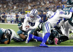 Dallas Cowboys running back Ezekiel Elliott (21) reaches the end zone for a touchdown against the Philadelphia Eagles in the first half of an NFL football game in Arlington, Texas, Sunday, Oct. 20, 2019. (AP Photo/Ron Jenkins)