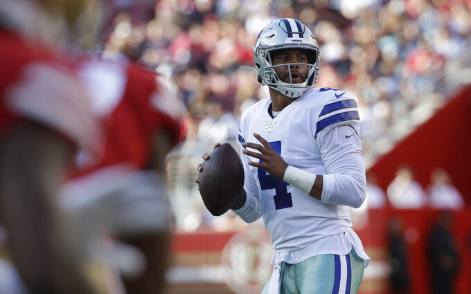 Dallas Cowboys quarterback Dak Prescott looks for a receiver during the first half of the team's NFL preseason football game against the San Francisco 49ers in Santa Clara, Calif., Saturday, Aug. 10, 2019. (AP Photo/Jeff Chiu)