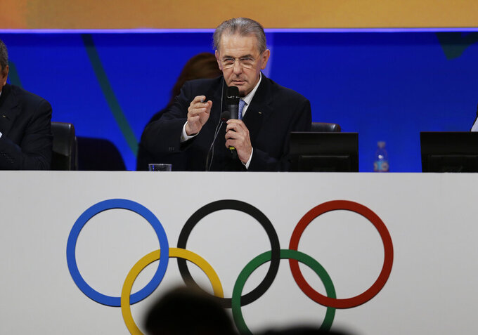 FILE - In this Saturday, Sept. 7, 2013 file photo, International Olympic Committee (IOC) President Jacques Rogge addresses the IOC session during the 2020 bid presentation during the International Olympic Committee session in Buenos Aires,, Argentina. The International Olympic Committee on Sunday, Aug, 29, 2021 says Jacques Rogge who led the organization as president for 12 years, has died. He was 79. (AP Photo/Natacha Pisarenko, file)