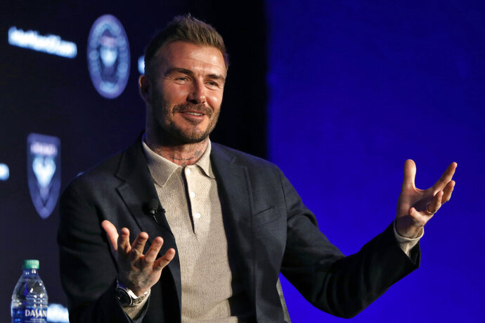 """FILE - David Beckham, Inter Miami CF co-owner, is interviewed during the Major League Soccer 25th Season kickoff event in New York, in this Wednesday, Feb. 26, 2020, file photo. David Beckham bristled when asked whether Phil Neville's was hired as Inter Miami coach because they're buddies. """"Of course, people are always going to turn around and say, oh, it's because he's your friend. It's nothing to do with him being my friend,"""" Beckham said Friday, Jan. 22, 2021. (AP Photo/Richard Drew, FIler)"""