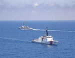 In this photo provided by U.S. Coast Guard,  Legend-class U.S. Coast Guard National Security Cutter Munro (WMSL 755) transits the Taiwan Strait during a routine transit with Arleigh Burke class guided-missile destroyer USS Kidd (DDG 100) on Aug. 27, 2021. China's defense ministry protested Saturday the passage of a U.S. Navy warship and Coast Guard cutter through the waters between China and Taiwan, a self-governing island claimed by China.(U.S. Coast Guard via AP)