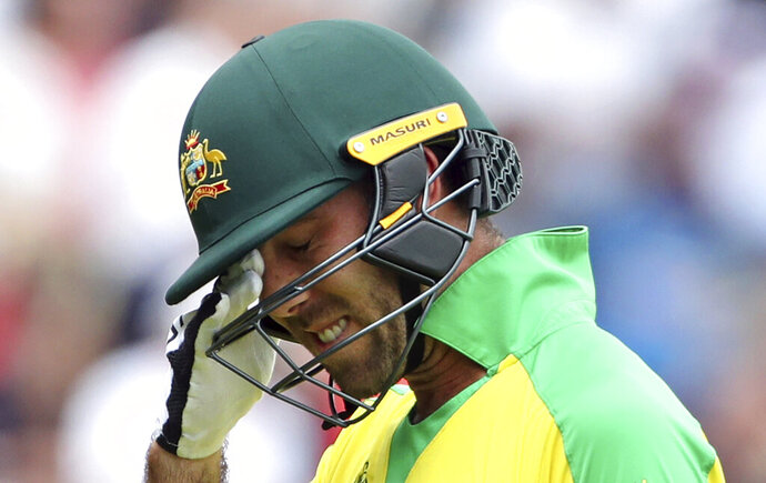 FILE - In this July 11, 2019, file photo, Australia's Glenn Maxwell reacts as he leaves the field after being dismissed by England's Jofra Archer during the Cricket World Cup semi-final match between England and Australia at Edgbaston in Birmingham, England. A serious health concern is emerging in Australian cricket. The first test of the home summer starts in Brisbane next week and Australia has three players out of the selection frame because of mental health reasons. (AP Photo/Aijaz Rahi, IFle)