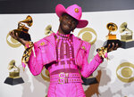 Lil Nas X poses in the press room with the awards for best music video and best pop duo/group performance for