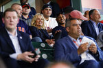 First lady Jill Biden and Doug Emhoff sit with military members and first responders as they attend a baseball game between the Houston Astros and the Baltimore Orioles at Minute Maid Park, in Houston, Tuesday, June 29, 2021. (AP Photo/Carolyn Kaster, Pool)