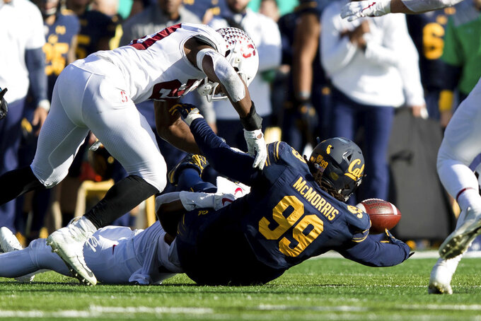 California fullback Malik McMorris (99) fumbles the ball for a turnover to Stanford in the second quarter of a football game in Berkeley, Calif., Saturday, Dec. 1, 2018. (AP Photo/John Hefti)