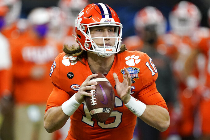FILE - Clemson quarterback Trevor Lawrence passes against Ohio State during the first half of the Sugar Bowl NCAA college football game in New Orleans, in this Friday, Jan. 1, 2021, file photo. Jacksonville's draft prospects helped lure Urban Meyer out of coaching retirement. The No. 1 choice, an opportunity to grab Clemson star Trevor Lawrence and secure a franchise quarterback for the foreseeable future. (AP Photo/John Bazemore, File)