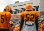 Players wait their turn at being coached on blocking during Rock Bridge High School's football practice on Thursday, Aug. 27, 2020, in Columbia, Mo. Their first game of the season is Friday with reduced fan capacity due to the coronavirus. (Ethan Weston/Missourian via AP)
