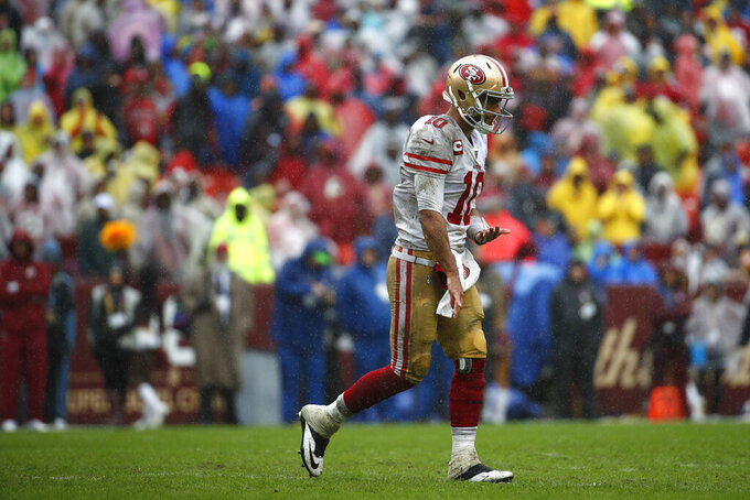 San Francisco 49ers quarterback Jimmy Garoppolo walks off the field after not being able to convert for a first down in the first half of an NFL football game against the Washington Redskins, Sunday, Oct. 20, 2019, in Landover, Md. (AP Photo/Alex Brandon)