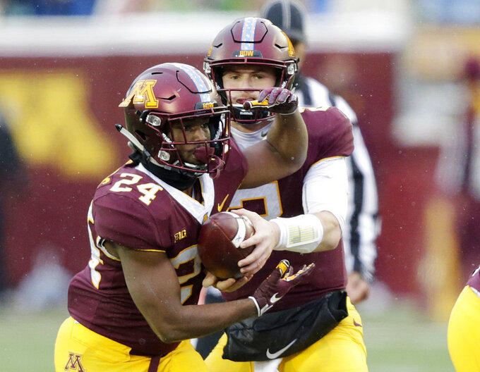 Minnesota running back Mohamed Ibrahim (24) receives a hand off from Tanner Morgan (2) in the third quarter against Purdue in a NCAA college football game Saturday, Nov. 10, 2018, in Minneapolis. (AP Photo/Andy Clayton-King)