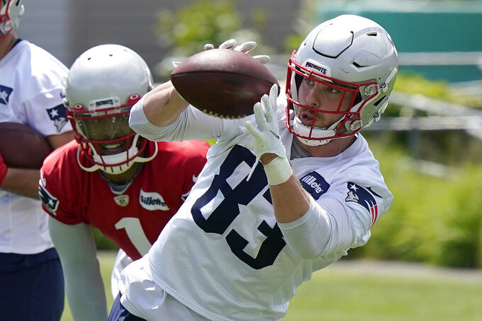New England Patriots tight end Matt LaCosse (83) makes a catch as quarterback Cam Newton (1) looks on during NFL football practice in Foxborough, Mass., Thursday, May 27, 2021. (AP Photo/Steven Senne)