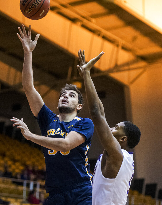 FILE - In this Thursday, Feb. 14, 2019, file photo, Drexel forward Alihan Demir (30) shoots against James Madison guard Darius Banks (5) during the first half of an NCAA college basketball game in Harrisonburg, Va. On Tuesday, May 7, 2019, Minnesota announced that they've added former Drexel forward Demir as a graduate transfer for the 2019-20 season. (Daniel Lin/Daily News-Record via AP)