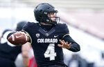 Colorado quarterback Sam Noyer looks to pass the ball against Utah in the first half of an NCAA college football game Saturday, Dec. 12, 2020, in Boulder, Colo. (AP Photo/David Zalubowski)