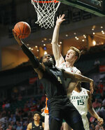 Pittsburgh guard Jared Wilson-Frame, left, goes up for a shot against Miami forward Sam Waardenburg, right, during the second half of an NCAA college basketball game, Tuesday, March 5, 2019, in Coral Gables, Fla. Miami defeated Pittsburgh 76-63. (AP Photo/Wilfredo Lee)