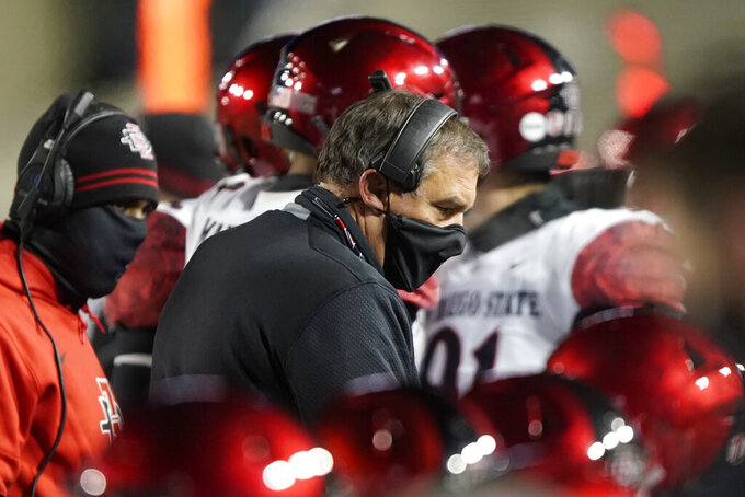 San Diego State coach Brady Hoke talks to his defense during the first half of the team's NCAA college football game against BYU on Saturday, Dec. 12, 2020, in Provo, Utah. (AP Photo/George Frey, Pool)