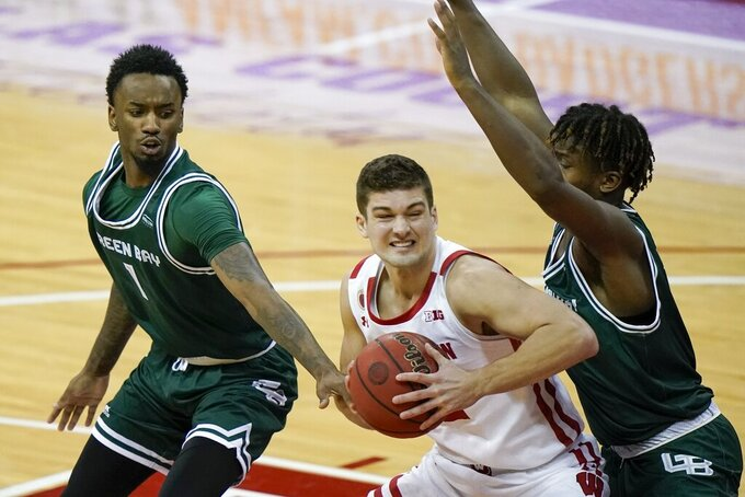 Wisconsin's Trevor Anderson drives during the second half of an NCAA college basketball game against Wisconsin-Green Bay Tuesday, Dec. 1, 2020, in Madison, Wis. (AP Photo/Morry Gash)