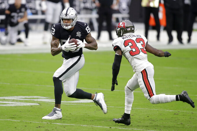 Las Vegas Raiders tight end Darren Waller (83) runs against Tampa Bay Buccaneers free safety Jordan Whitehead (33) during the first half of an NFL football game, Sunday, Oct. 25, 2020, in Las Vegas. (AP Photo/Isaac Brekken)