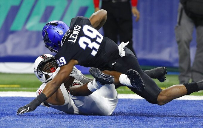 Northern Illinois wide receiver D.J. Brown, defended by Buffalo cornerback Cameron Lewis (39), falls into the end zone after catching a 8-yard pass for the go-ahead touchdown during the second half of the Mid-American Conference championship NCAA college football game, Friday, Nov. 30, 2018, in Detroit. (AP Photo/Carlos Osorio)