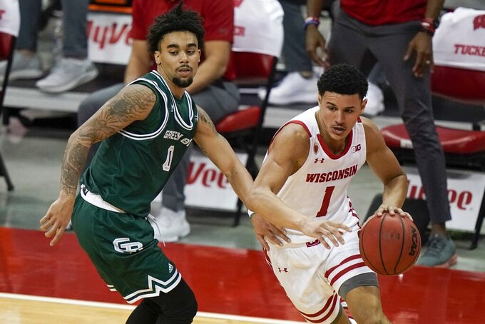 Wisconsin's Jonathan Davis drives past Wisconsin-Green Bay's Josh Jefferson during the second half of an NCAA college basketball game Tuesday, Dec. 1, 2020, in Madison, Wis. (AP Photo/Morry Gash)