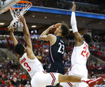 Cincinnati's Zach Harvey, center, tries to shoot between Ohio State's D.J. Carton, left, and Andre Wesson during the first half of an NCAA college basketball game Wednesday, Nov. 6, 2019, in Columbus, Ohio. (AP Photo/Jay LaPrete)