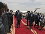 President of the Sudanese Transitional Council General Abdel Fattah al-Burhan, right, walks on the red carpet with Eritrean President Isaias Afwerki on his arrival at the Khartoum airport in Khartoum, Sudan, Tuesday, May 4, 2021. Eritrea's president arrived in Khartoum on Tuesday for talks with Sudanese officials amid tensions between the two countries over the Tigray conflict on Sudan's border. (AP Photo/Marwan Ali)