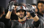 FIL - In this Sept. 4, 2017, file photo, Arizona Diamondbacks' J.D. Martinez gestures toward the camera as he stands in the dugout after hitting his fourth home run of the game in the ninth inning of a baseball game against the Los Angeles Dodgers, in Los Angeles. Perhaps 100 free agents still seek contracts as the start of spring training workouts on Feb. 14 draws near, a group that includes J.D. Martinez, Eric Hosmer, Mike Moustakas, Jake Arrieta and Yu Darvish. (AP Photo/Mark J. Terrill, File)