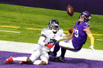Tennessee Titans cornerback Malcolm Butler, left, breaks up a pass intended for Minnesota Vikings wide receiver Adam Thielen (19) in the end zone during the first half of an NFL football game, Sunday, Sept. 27, 2020, in Minneapolis. (AP Photo/Jim Mone)