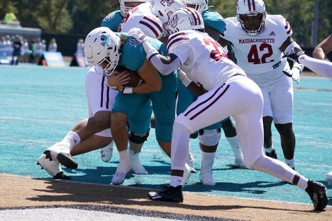 Coastal Carolina quarterback Grayson McCall scores against Massachusetts during the first half of an NCAA college football game on Saturday, Sept. 25, 2021, in Conway, S.C. (AP Photo/Chris Carlson)