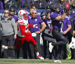 Northwestern's Flynn Nagel, right, makes a catch as Nebraska's Aaron Williams looks on during the second half of an NCAA college football game Saturday, Oct. 13, 2018, in Evanston, Ill.. (AP Photo/Jim Young)